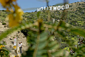 tourists in front of the Hollywood sign, emblem, Los Angeles, L.A., Caifornia, U.S.A., United States of America