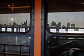 Windows of a ferry reflecting Manhattan's skyline, Manhattan, New York, America, USA