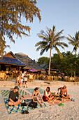 People sitting at white sandy beach of Hat Rai Leh, Railay West, Laem Phra Nang, Railay, Krabi, Thailand, after the tsunami