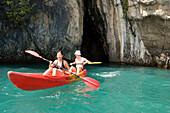 Couple kayaking around Ko Hong, Phang Nga bay, Krabi, Thailand, after the tsunami