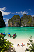 """View over Maya Bay, a beautiful scenic lagoon, famous for the Hollywood film """"The Beach"""" with sunbathing tourists and anchored boats, Ko Phi-Phi Leh, Ko Phi-Phi Islands, Krabi, Thailand, after the tsunami"""