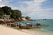 Long tail boats anchoring at beach of Ao Ton Sai, Banyan Tree Bay, Ko Phi Phi Don, Ko Phi Phi Island, Krabi, Thailand, after the tsunami