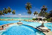 Couple sitting in a whirlpool, Pee Pee Island Village Beach Resort, Ko Phi Phi Don, Ko Phi Phi Islands, Krabi, Thailand, after the tsunami