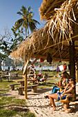 Couple sitting in a beach bar, Ao Lo Dalam, Lohdalum Bay, Ko Phi Phi Don, Ko Phi Phi Island, Krabi, Thailand, after the tsunami