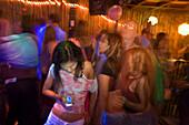 Phonmng, Girls dancing in a bar, Ko Phi Phi Don, Ko Phi Phi Island, Krabi, Thailand, after the tsunami