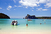 Tourists bathing in shallow water, Ao Lo Dalam, Lohdalum Bay, Ko Phi Phi Don, Ko Phi Phi Island, Krabi, Thailand (after the tsunami)