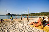 Young people playing beach volleyball, Ao Lo Dalam, Lohdalum Bay, Ko Phi Phi Don, Ko Phi Phi Island, Krabi, Thailand, after the tsunami
