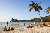Tourists sunbathing at beach Ao Lo Dalam, Lohdalum Bay, Ko Phi Phi Don, Ko Phi Phi Island, Krabi, Thailand, after the tsunami