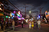 Tourists strolling over Bang-La Road in the late evening, bar district, Patong Beach, Ao Patong, Hat Patong, Phuket, Thailand, after the tsunami
