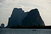 Fishing boat, Cliffy scenery, Phang-Nga Bay, Ao Phang Nga Nation Park, Phang Nga, Thailand