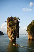 View to Koh Tapu, so-called James Bond Island, The Man with the Golden Gun, people in a longtail boat in foreground, Ko Khao Phing Kan, Phang-Nga Bay, Ao Phang Nga Nation Park, Phang Nga, Thailand