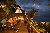 "Vacationers sitting in the restaurant ""On the Rocks"" in the evening, Marina Cottage Phuket, Karon Beach, Ao Katong, Hat Katong, Phuket, Thailand, after the tsunami"