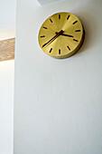 Golden clock on wall, low angle view, Loretta Bar, Munich