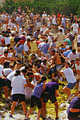 Group of people having a grape fight at the Wine Festival, Benissalem, Mallorca, Spain