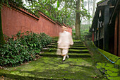 Nun at the picturesque Fuhu convent, Emei Shan, Sichuan province, China, Asia