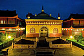 Illuminated buildings of the Wannian Monastery at night, Emei Shan, Sichuan Province, China, Asia