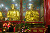 Prayer, Statues of the past, the present and the future Buddha, Wannian monastery and temple, World Heritage Site, UNESCO, China, Asia