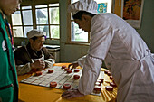 kitchen staff of a small restaurant next to the path play chinese Chess, Emei Shan Mountains, China, Asia, World Heritage Site, UNESCO