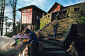 pilgrims, sales people, stalls, porter, Xixiang Chi monastery and temple, Elephant Bathing Pool, Emei Shan mountains, World Heritage Site, UNESCO, China, Asia