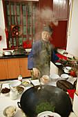 kitchen, cooking with wok, Huangting convent, nunnery, Heng Shan south, Hunan province, Hengshan, Mount Heng, China, Asia