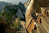 pilgrim path along stone steps, blue dragon ridge, with chain handrail, Hua Shan, Shaanxi province, Taoist mountain, China, Asia