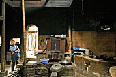 traditional kitchen, timber house in Chengkun, ancient village, living museum, China, Asia, World Heritage Site, UNESCO