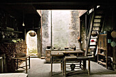Interior view of a traditional kitchen at an old timber house in Chengkun, Hongcun, China, Asia