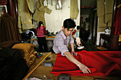 People working at a tailor shop for Buddhist monks robes, Jiuhuashan, Anhui province, China, Asia
