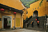 Pilgrims on stairs in front of Sangchan monastery, Jiuhuashan, Anhui province, China, Asia