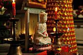 White Jade Buddha in the candlelight, Sangchan Monastery, Jiuhuashan, Anhui province, China, Asia