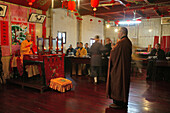 Abbot and monks at the dining hall of the Longevity monastery, Jiuhua Shan, Anhui province, China, Asia