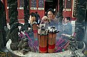 Believers burning incense sticks, Jiuhua Shan, Anhui province, China, Asia
