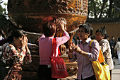 pilgrims touch bronze cauldron, hope for healing energy, Fayu Monastery on the Buddhist Island of Putuo Shan near Shanghai, Zhejiang Province, East China Sea, China, Asia
