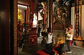 gate temple of Huiji monastery, pilgrims praying, Buddhist Island of Putuo Shan near Shanghai, Zhejiang Province, East China Sea, China, Asia