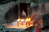 Shrine next to Thousand stone steps stairway, Buddha statue, candles and incense in stone altar, Buddhist Island of Putuo Shan near Shanghai, Zhejiang Province, East China Sea, China, Asia
