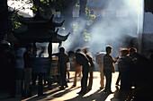 Pilgrims and tourists praying at Puji Si Temple, Buddhist Island of Putuo Shan near Shanghai, Zhejiang Province, China
