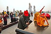 Buddha statues from house altars brought to Guanyin, pilgrims, Goddess of Mercy, Buddhist Island of Putuo Shan near Shanghai, Zhejiang Province, East China Sea, China, Asia