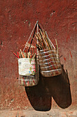 chopsticks, in basket on wall, Song Shan, Henan province, China, Asia