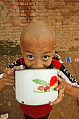 young boy at breakfast,  one of many new Kung Fu schools in Dengfeng, near Shaolin, Song Shan, Henan province, China, Asia