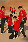 stretch exercises before morning Kung Fu training, a school near Shaolin monastery, Song Shan, Henan province, China, Asia