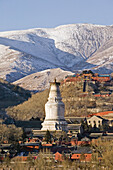 Mountains of  Wutai Shan in winter snow, Five Terrace Mountain, Great White Pagoda, Northern Terrace, Buddhist Centre, town of Taihuai, Shanxi province, China, Asia
