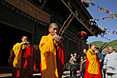 monks in yellow and red robes play bamboo mouth organ and flute, during birthday of Wenshu, Xiantong Monastery, Wutai Shan, Five Terrace Mountain, Buddhist Centre, town of Taihuai, Shanxi province, China, Asia