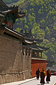 high walls of Xiantong monastery, buddhist monks, courtyard, during birthday of Wenshu, Xiantong Monastery, Wutai Shan, Five Terrace Mountain, Buddhist Centre, town of Taihuai, Shanxi province, China, Asia