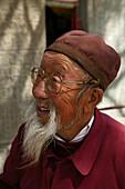 Elderly bearded monk with glasses, Taihuai, Mount Wutai, Wutai Shan, Five Terrace Mountain, Buddhist Centre, town of Taihuai, Shanxi province, China