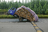 Heavy load, overloaded three-wheeler, China, Asia