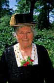 Elderly woman in dirndl dress with gold-ornamented hat, pilgrimage to Raiten, Schleching, Chiemgau, Upper Bavaria, Bavaria, Germany