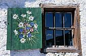Window of an alpine hut with paintings on the window shutter, Steinplatte, Chiemgau Alps, Tyrol, Austria