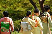 Four japanese women in kimonos, Happo-en Garden, Tokyo, Japan