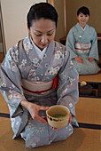 Two Japanese women preparing the tea ceremony in Hosomi museum, Kyoto, Japan