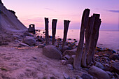 Wooden stakes on the beach at dusk, Cape of Arkona, Rugen Island, Mecklenburg Western Pommerania, Germany